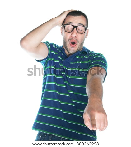Laughing man watching TV or looking to laptop - PC computer. Guy in front of a monitor, isolated on white background, studio shot. - stock photo