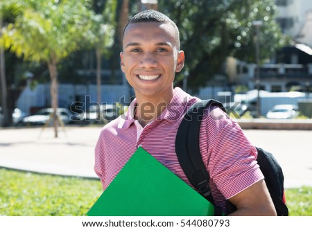 Laughing mexican male student in the city
