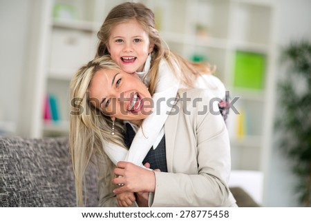 Laughing mother and daughter, happy family  - stock photo