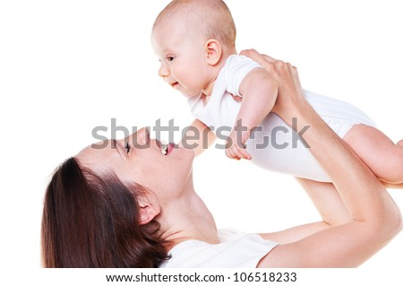 laughing mother holding her baby. isolated on white background