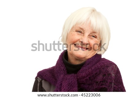 Laughing older woman on white background with space to copy - stock photo