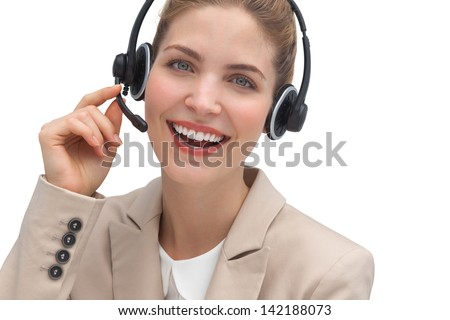 Laughing operator talking on headset looking at the camera