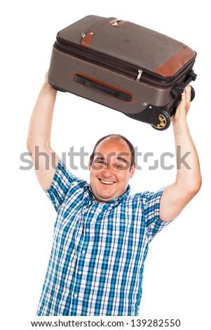 Laughing passenger man lifting up his luggage, isolated on white background - stock photo