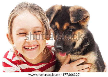 laughing pretty girl with a German Shepherd puppy