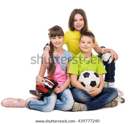 laughing schoolchildren with sport equipment on the floor isolated on white background - stock photo