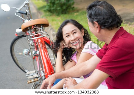 Laughing senior woman in the focus - stock photo