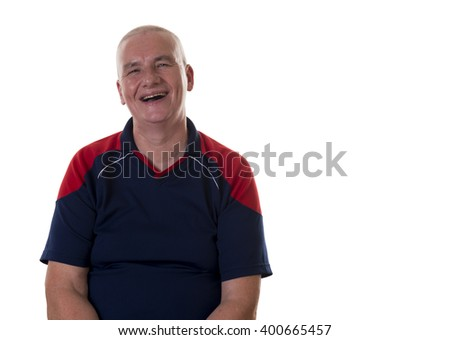 Laughing single middle aged male with bald head and blue and red shirt sitting over white background
