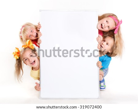 laughing small kids on a white background with big white banner - stock photo