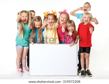 laughing small kids on a white background with white banner and thumbs up signs - stock photo