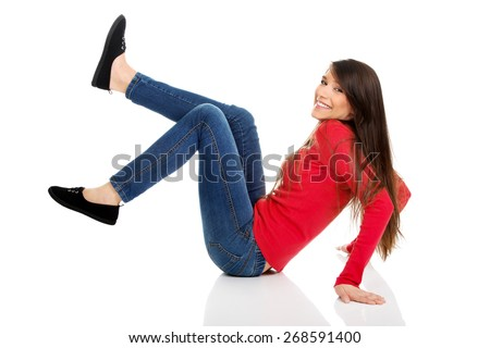 Laughing student woman with legs up on the floor. - stock photo