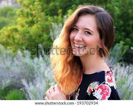 Laughing teenage girl with backlit hair, Utah, USA. - stock photo