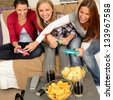 Laughing teenage girls playing with video game with consoles - stock photo