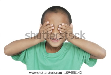 Laughing teenager in a purple sweater shut his eyes with his hands