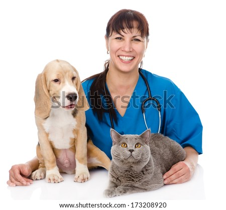 laughing veterinarian hugging cat and dog. isolated on white background