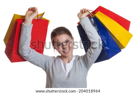 Laughing woman after shopping - stock photo