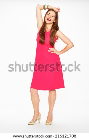 Laughing woman full body portrait isolated on white background. Red dress.