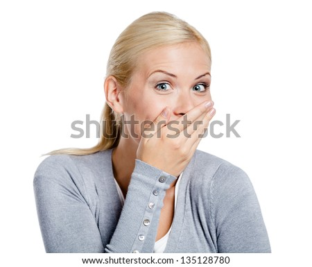 Laughing woman in gray sweater covers mouth with hand, isolated on white - stock photo