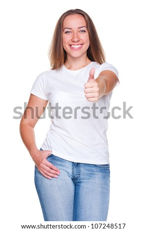 laughing woman in white t-shirt and jeans showing thumbs up. studio shot over white background