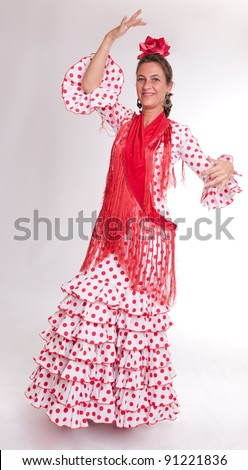 Laughing woman wearing a typical folkloric Sevillian costume