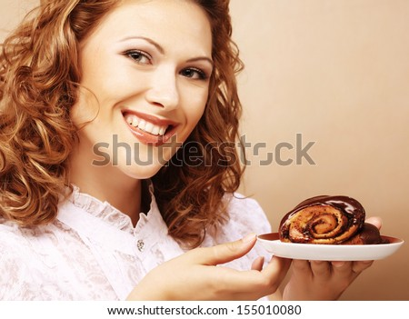 laughing woman with cake - stock photo