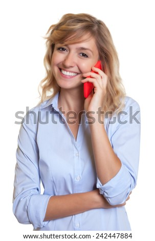 Laughing woman with curly blond hair at phone - stock photo