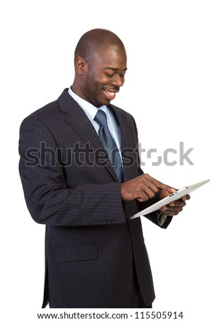 Laughing Young African American Male Businessman Texting on a Touch Pad Tablet PC on Isolated White Background