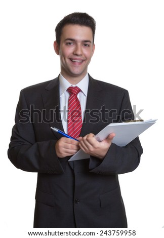 Laughing young businessman with clipboard - stock photo