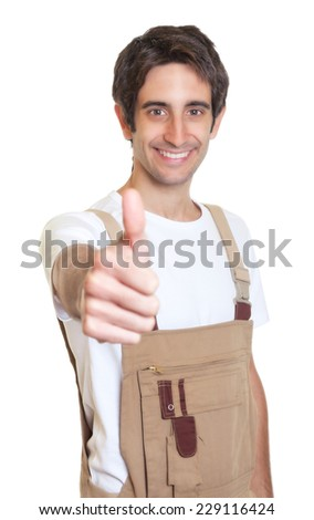 Laughing young carpenter showing thumb - stock photo
