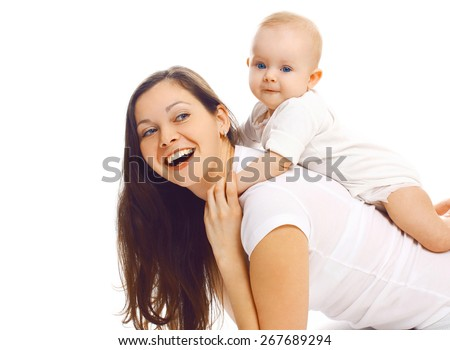 Laughing young mother playing with baby and having fun together - stock photo