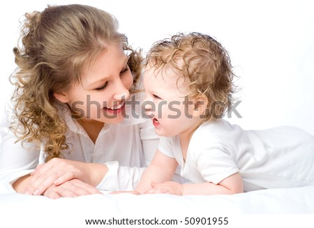 Laughing young mum and the kid on a white - stock photo