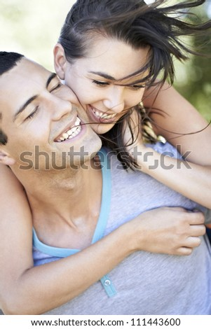 Laughing young romantic couple - stock photo