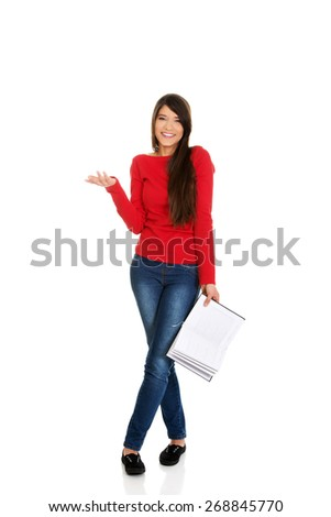 Laughing young student woman with her note. - stock photo