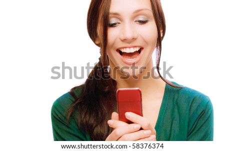 Laughing young woman reads sms, on white background. - stock photo