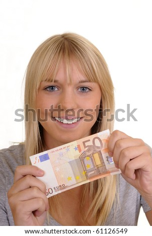 laughing young woman with 50 Euro - stock photo