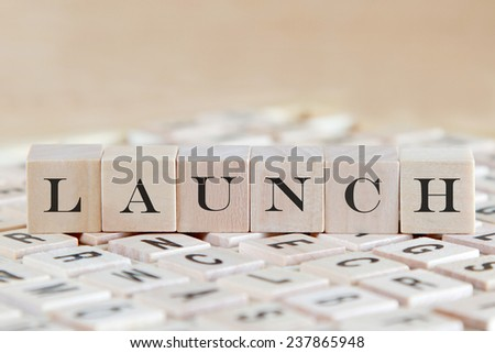 launch word background on wood blocks - stock photo