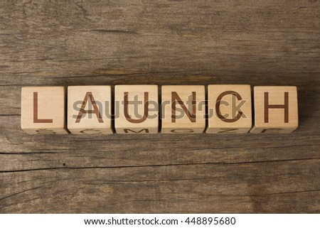 LAUNCH word in vintage wooden blocks