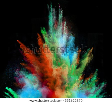 Launched colorful powder on black background - stock photo