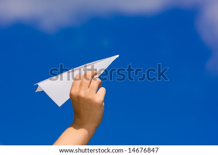 launching a paper plane - stock photo