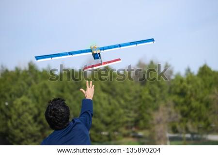 Launching radio controlled airplane - stock photo