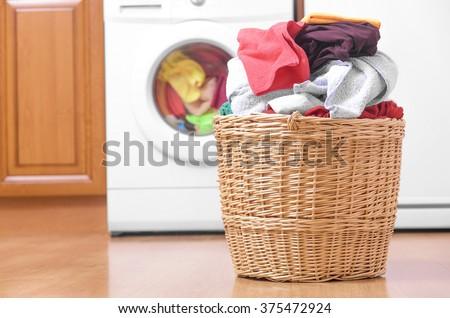 Laundry basket on the background of the washing machine. - stock photo
