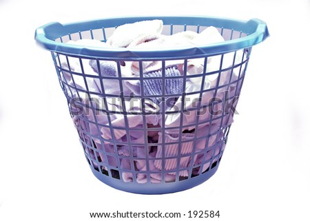 laundry basket with clothes - stock photo
