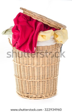 Laundry Basket with colorful laundry over white - stock photo