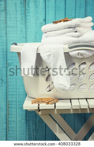 Laundry basket with towels and socks - stock photo