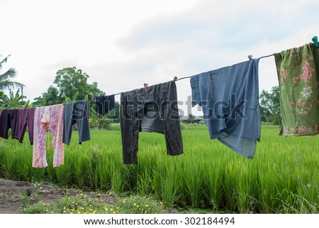 laundry clothes hanging outdoors - stock photo