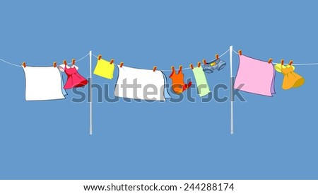 Laundry drying on the rope outside  - stock photo