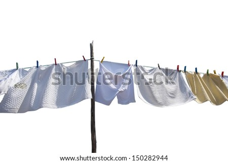 Laundry drying on the rope outside on a sunny day, isolated on white