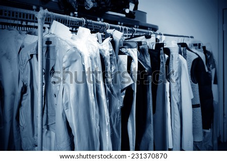 Laundry, hanging on the racks of old clothes. - stock photo