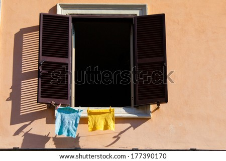 Laundry hanging out of a typical italian facade.  - stock photo