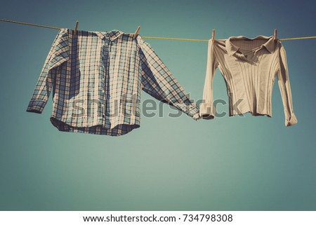 Laundry hanging out to dry, holding hands