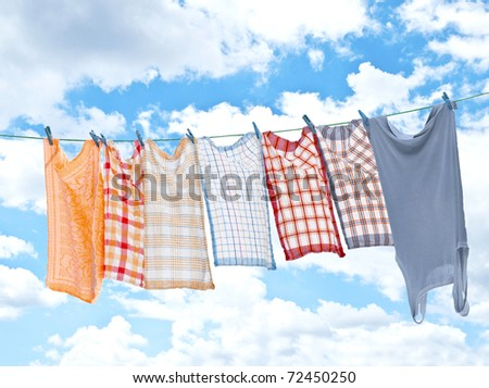 Laundry hanging over sky - stock photo